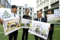 (From left) St Joseph's College student Sam Leung; architect Billy Tam; principal Perrick Ching; and student Avery Cheung hold up artist impressions of the future campus. Photo: May Tse