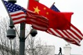 A Secret Service agent guards his post on the roof of the White House as a lamp post is adorned with Chinese and US national flags. The Pentagon's move to counter China in the Indo-Pacific is certain to vex Beijing. Photo: AFP