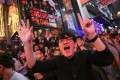 """Revellers shout """"Five demands, not one less"""" as they celebrate the New Year in Lan Kwai Fong. Photo: Sam Tsang"""