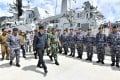 Indonesian President Joko Widodo (centre) inspects troops on a navy ship at Selat Lampa Port in the Natuna Islands on January 8. Photo: AP