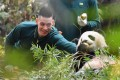 Team North's Jeremy Lin interacts with giant panda Longlong at Chimelong Safari Park in Guangzhou ahead of the of Chinese Basketball Association All-Star game. Photo: Xinhua