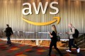Attendees at Amazon's annual cloud computing conference walk past the Amazon Web Services logo in Las Vegas US, in November 2017. File photo: Reuters