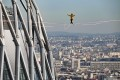 A tightrope walker performs above the business district of La Defense on the outskirts of Paris on November 22. The district has begun to attract robust foreign investment in real estate, including from South Korean investors. Photo: AFP