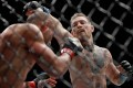 Conor McGregor punches Eddie Alvarez in their UFC lightweight championship fight at UFC 205 in November 2016. Photo: AFP