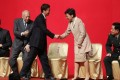 Liaison office director Luo Huining shakes hands with Chief Executive Carrie Lam during the spring reception. Photo: Sam Tsang