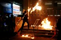 An anti-government protester throws a petrol bomb at Hung Hom MTR station during a rally on December 1. Photo: Reuters