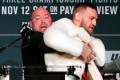 Conor McGregor (right) is restrained by UFC president Dana White during a news conference ahead of his UFC 205 against Eddie Alvarez in 2018. Photo: AP