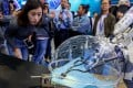 Members of the media look at a robot system for porotic laparoscopic surgery during a preview of the National Mass Innovation and Entrepreneurship Week in Beijing in October 2018. The US has criticised China for intellectual property theft. Photo: Xinhua