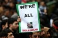 A mourner holds up a picture of Qassem Soleimani, the Iranian general killed in an air strike at Baghdad airport, during a rally in his memory in Tehran on January 4. Photo: Reuters
