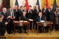 Chinese Vice-Premier Liu He and US President Donald Trump at the White House on Wednesday. A phase one trade deal signed between the world's two largest economies will benefit China's stock markets, analysts say. Photo: Xinhua