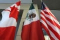 The Canadian, Mexican and US flags hang in the lobby during trade negotiations in Ottawa in September 2017. Photo: AFP