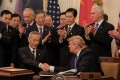 Chinese Vice-Premier Liu He and US President Donald Trump shake hands after signing the phase one trade deal at the White House in Washington on January 15. Photo: EPA-EFE