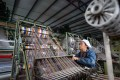 A weaver works on a loom at a plant in Qionglai city, in southwest China's Sichuan province. China's economy grew 6.1 per cent year on year in 2019, within the government's annual target of 6 to 6.5 per cent. Photo: Xinhua