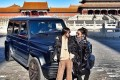 Pictures of the two women posing in front of the SUV prompted an outcry on social media. Photo: Weibo