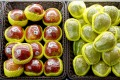 Fruit packaged in plastic are on display at a supermarket in Beijing, China. Photo: Reuters