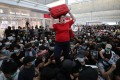 A traveller loses patience with protesters at Hong Kong airport, who occupied the site in August. Photo: Sam Tsang