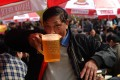 A Vietnamese man drinking during a local beer festival in Hanoi. Photo: AFP