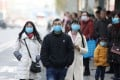 Chinese residents wear masks while waiting at a bus station near the closed Huanan Seafood Wholesale Market, which has been linked to cases of a new strain of coronavirus identified as the cause of the pneumonia outbreak in Wuhan on 20 January 2020. Photo: EPA-EFE