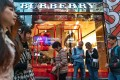 Pedestrians walk past a Burberry Group store on Canton Road in Tsim Sha Tsui, Hong Kong. Photo: Bloomberg