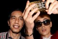 Indonesian President Joko Widodo and singer Justin Bieber do a selfie on one of Agan Harahap's photos. Photo: courtesy of Agan Harahap