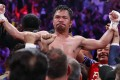 Manny Pacquiao celebrates after defeating Keith Thurman by split decision in a welterweight title fight in 2019. Photo: AP