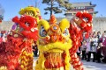 Artists perform a lion dance at Shanhaiguan Pass, in Qinhuangdao city, Hebei province, in northern China. Photo: Xinhua