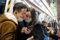 Subway passengers wear protective masks in Beijing on January 21, 2020. Photo: AFP