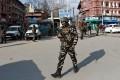 An Indian security officer patrols a street in Srinagar, Kashmir, on January 10, 2020. Photo: Reuters