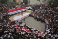 Iraqis gather in Baghdad to demand an end to the presence of US forces in their country. Photo: AFP