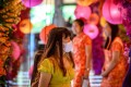 A woman with a face mask walks through a shop decorated for the Lunar New Year in Bangkok on January 24, after five people were detected with the coronavirus in Thailand. Photo: AFP