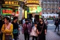 Pedestrians wear face masks in Macau on January 22, after the former Portuguese colony reported its first case of the new coronavirus that originated from Wuhan in mainland China. Photo: AFP