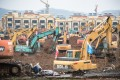 Dozens of excavators break ground for the new coronavirus facility in Wuhan, expected to be completed within six days. Photo: Xinhua