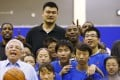 Kobe Bryant, Yao Ming and NBA commissioner David Stern pose with children during the NBA Cares Special Olympics Basketball Clinic in Shanghai in 2013. Photo: AP