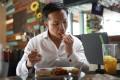 French-Vietnamese MMA fighter Marc Guyon tucks into a vegetarian meal at Hemingway's restaurant inDiscovery Bay, Lantau Island, Hong Kong. Photo: Winson Wong