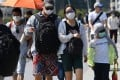 Visitors wear protective face masks at the Marina Bay waterfront in Singapore on January 26 amid the Wuhan virus scare. Photo: AFP