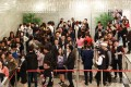 Potential buyers queue up for Sun Hung Kai Properties' offer of 335 flats at its Wetland Seasons Park residential project, on January 11. Ricacorp expects new flat sales to boost property transactions this year. Photo: May Tse