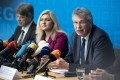 President of the Bavarian state office for health and food safety, Andreas Zapf (third left) and Bavarian Health Minister Melanie Huml (centre) speak during a news conference to confirm a German case of coronavirus. Photo: EPA-EFE