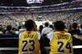 Los Angeles Lakers fans in LeBron James and Kobe Bryant jerseys watch the NBA China Games 2019 in Shanghai. Photo: Reuters