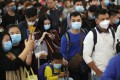 Travellers wear masks as they queue at the High Speed Rail Station in West Kowloon. Given the acute situation with the coronavirus, officials should put public health above politics and adopt immediate and decisive measures when needed. Photo: Winson Wong