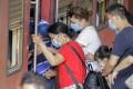 Chinese tourists wear protective masks at a railway station in Colombo, Sri Lanka, on Monday. Photo: EPA-EFE
