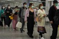 Masked passengers at Hong Kong International Airport. Photo: AP