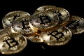 A collection of Bitcoin (virtual currency) tokens are displayed, 2017. Photo: Reuters