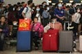 Travellers queuing at the West Kowloon terminus of the high-speed rail to mainland China wear masks. Photo: Winson Wong