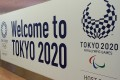 A 'Welcome to Tokyo 2020' board greets arrivals – including the thousands of athletes who will compete – at Haneda Airport in Japan. Photo: Shutterstock