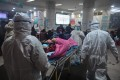 Medical staff admit a new coronavirus patient at the Wuhan Red Cross Hospital in Wuhan. Photo: AFP