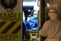 The new male coronavirus patient from Wuhan, in an ambulance at Queen Mary Hospital on Wednesday. Photo: May Tse