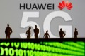 Small toy figures are seen in front of a displayed Huawei and 5G network logo in this illustration picture. Photo: Reuters