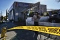 An area around the Kingdom of Jesus Christ Church in Los Angeles is closed off with crime scene tape on Wednesday. Photo: AP