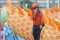 A child in Tsim Sha Tsui on January 24 is seen wearing a mask as protection against the coronavirus outbreak that originated Wuhan. Photo: Edmond So