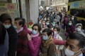 "Long queues to buy face masks at a cosmetics shop in Hong Kong on January 30, as world health officials expressed ""great concern"" that the disease is starting to spread between people outside mainland China. Photo: AP"
